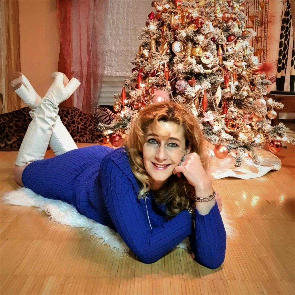 Foto vor dem Weihnachtsbaum